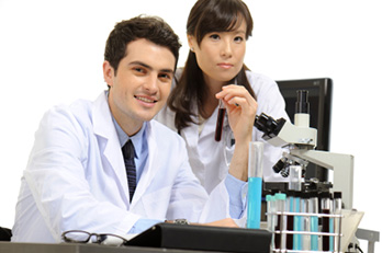 medical assistants with microscope